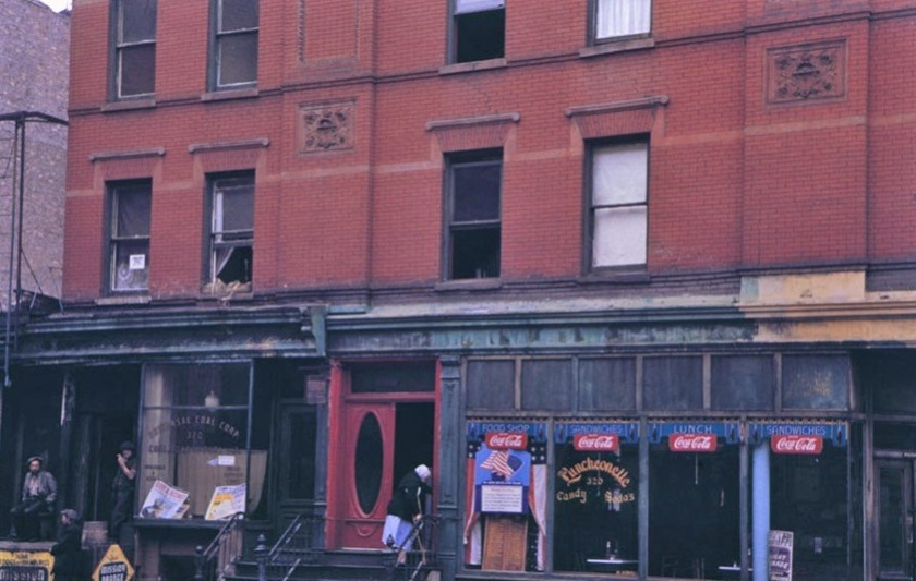 Store fronts below brick tenement (1942): Charles W. Cushman Photography Collection / Indiana University Archives